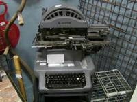 "This amazing metal-punching ""typewriter"" was used to"