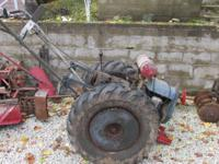 This Antique Twin Tractor is an oldie but goodie, Made