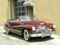 1947 Buick Super Convt, Burgundy with red interior.