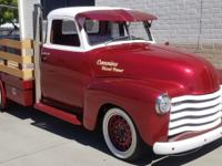 One of a kind 5-window custom staked pickup powered by