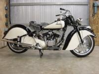 48 INDIAN CHIEF. THE MOTORCYCLE IS PAINTED BLACK &