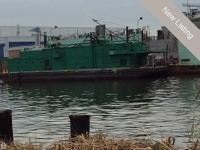 This is skimmer vacuum barge determining 95' by 30""