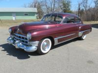 This is a 1949 Cadillac 61 series sedanet fastback