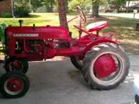 This tractor runs great and the paint is in decent shap