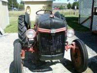 Red and Black 1949 Ford Tractor 8N Runs good and