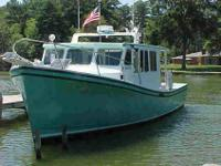 CUSTOM BUILT SOLID FIBERGLASS FISHING BOAT. Built by