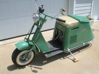 Here is a nice clean older restoration 1950 Cushman