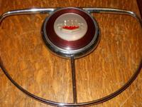 THIS 1950 FORD HORN RING WITH CENTER EMBLEM , CHROME