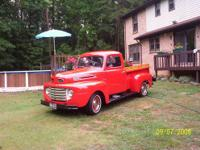 have a nice 50 ford truck, color is red, and black and
