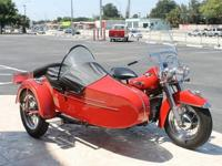and sidecar on display in a glass case in the