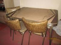 One table and 6 chairs.  This is a vintage used item