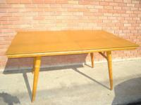 All wood table has rattan style legs (bentwood). Top is