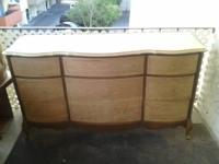 This is a beautiful all-wood dresser from the 50's. You