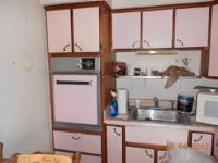 This is a complete PINK kitchen. Built in oven, stove