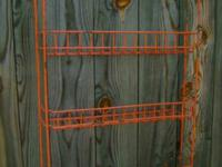 Unusual old metal kitchen rack has original orange