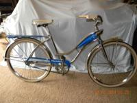 This is a Monark Woman's Bicycle from the 1950's. All