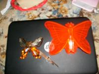 cleer site red-orange butterfly with ladies deal with,