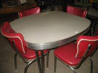 This is a very nice retro chrome table with four