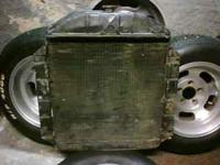 *1952 Ford Flat head radiator very good shape $ 225.00