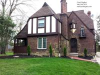 Charming brick Tudor design house on double lot.