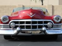 The Cadillac was finished in Sweet Rasberry Red that