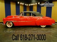 A bright red 1951 Chevrolet Bel Air Convertible is up