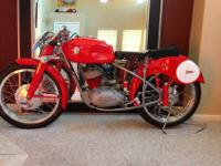 This is a 1951 Maserati 125 Prototype Motorcycle. It