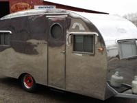 This is a 1951 Trotwood camper 18 Econo/Deluxe. This