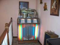 This is a 1951 Wurlitzer Juke box (1400 Model) with the