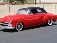 1952 Chevrolet Deluxe Convertible. The red exterior