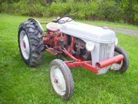 8n ford tractor , deceint rubber , runs good , works as