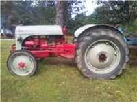 Selling good used tractor Still on 6volt system blade
