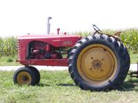 1952 Massey Harris 44, gas, one remote, rear tires