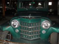 (2) 1952 Willys Wagons. The main Willys is Dark Green
