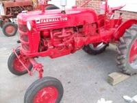 1953 Farmall Cub. Rebuilt engine, runs good. All lights