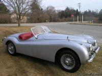 This is a 1953 Jaguar XK 120 Roadster that has