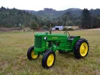 This Is a freshly restored 1953 John Deere model 40. It