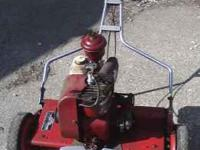 this is a 1953 toro sportlawn reel mower. in fairy good