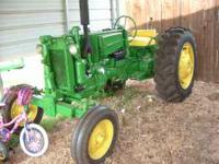 john deere tractor, runs, new rubber, new paint ...$
