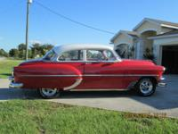 This 2 door 54 Chevy is restored with a 350 v8 no rust