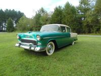 This is a 1955 Chevy BelAir 4 door sedan that is a