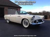 This 1955 Ford Thunderbird has a new soft top that also
