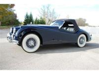 This 1955 Jaguar XK140 MC Roadster is finished in