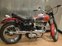You are looking at a beautiful 1955 Triumph T110 650