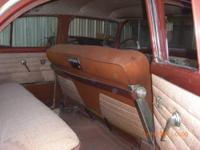 A stunning restored 56 Nomad with factory 265 V8,
