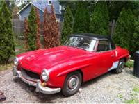 1956 Mercedes Benz 190SL. Red with black leather. Same