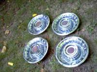 Set of 4 hubcaps from a 1957 Cadillac. In excellent