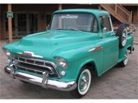 THE STYLISH 1957 PICKUP HAD A NEW CHROME GRILL WITH AN