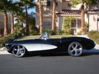 1957 Corvette. New black paint with silver coves. Clear