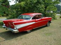 Beautiful red 57 Chevy, 2 door hard top, red and black